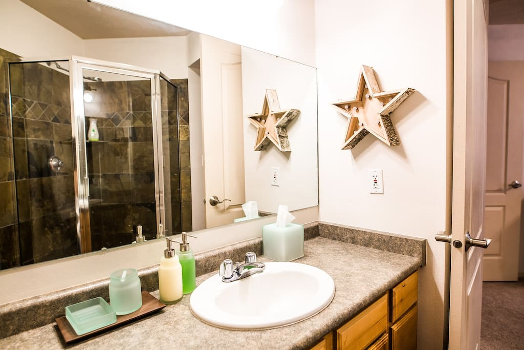 Master bath with shower. Stocked with basic bathroom necessities and plenty of fresh towels.