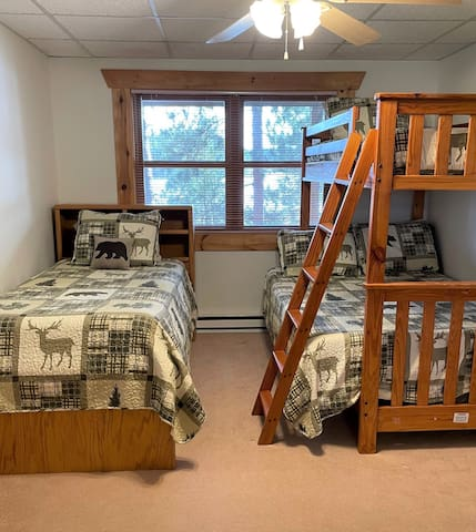 The 2nd lower level bedroom also has lake views and has a twin over full bunk and a separate twin bed.