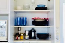Bowls, plates, glasses, coffee press, tea, spices, sugar, honey, olive oil...