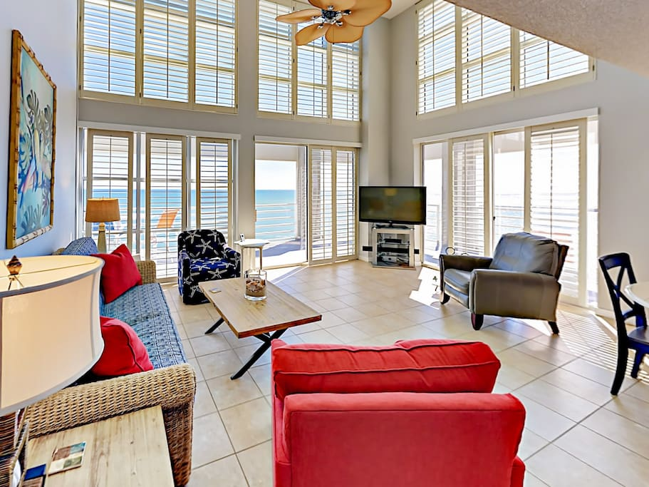 Bright, airy, and spacious living area - where floor-to-ceiling windows fill the space with sunlight.