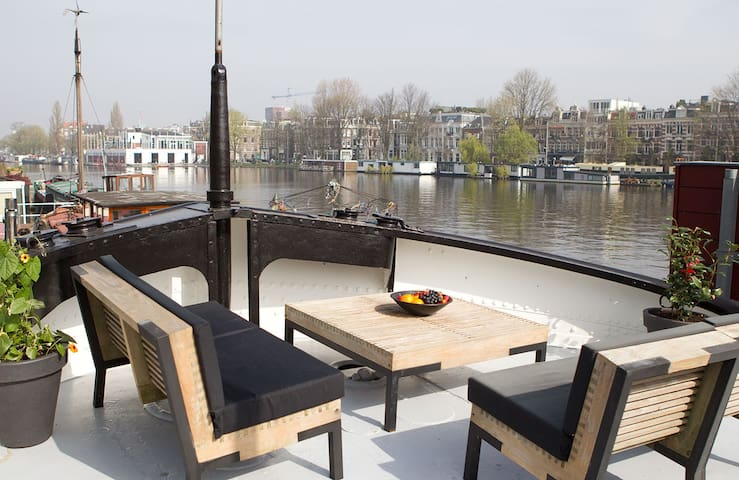 Amazing houseboat on Amstel river with sundeck
