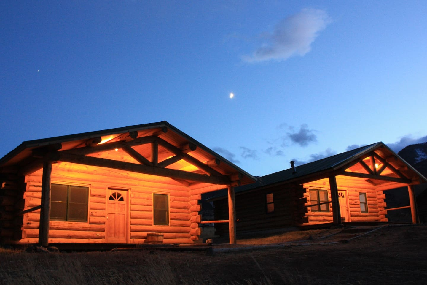 Our warm inviting cabins..the Elkhorn is the cabin on the right.