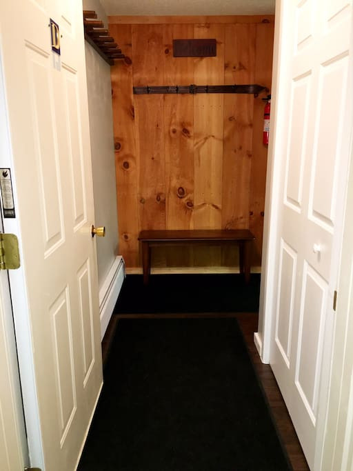 Entryway bench with ski rack and coat rack.
