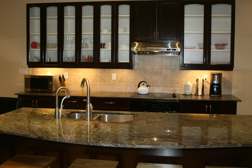 A huge island makes the difference in the kitchen.  Granite tops are everywhere.