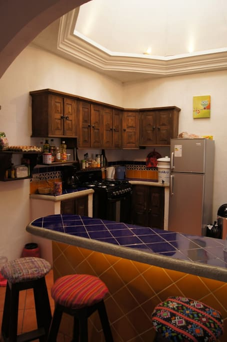 Spacious kitchen with a big gas stove, freezer, blender, eco-filtro for potable water, coffee maker, etc.