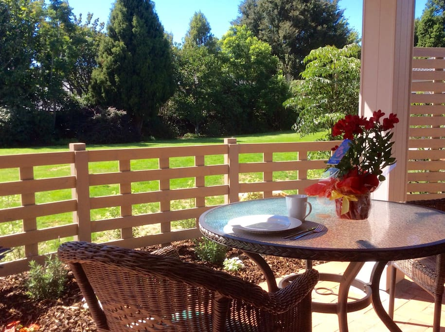 Private courtyard with view of woodland garden.