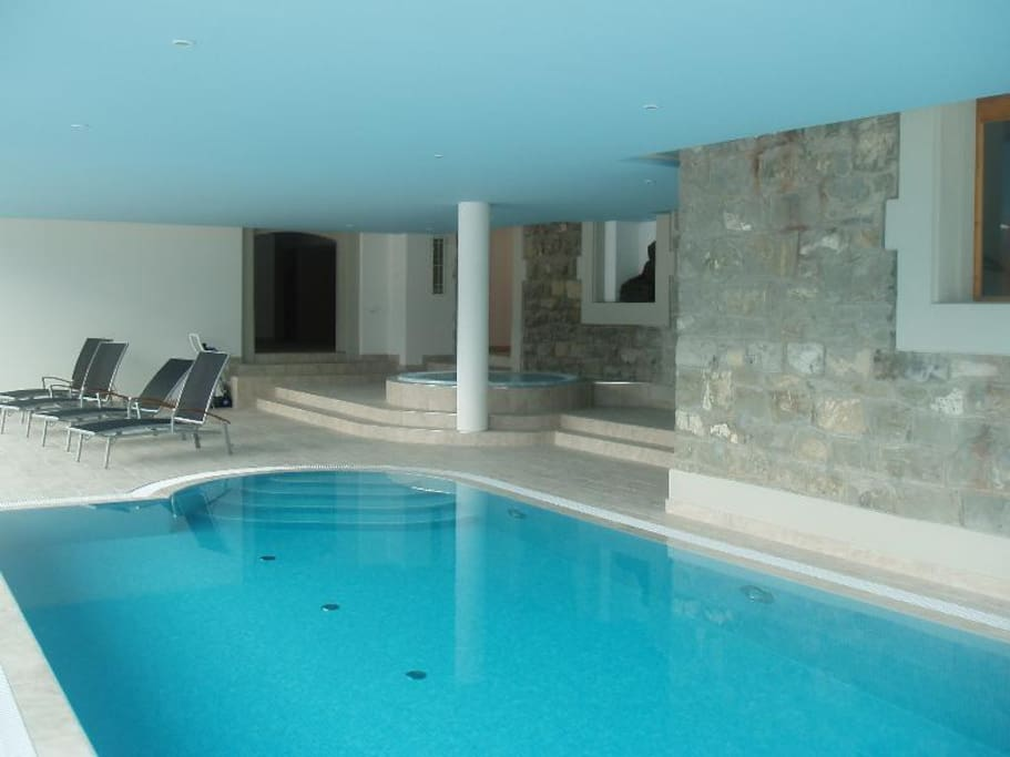 Another perspective of the indoor pool, jacuzzi, steam room and sauna