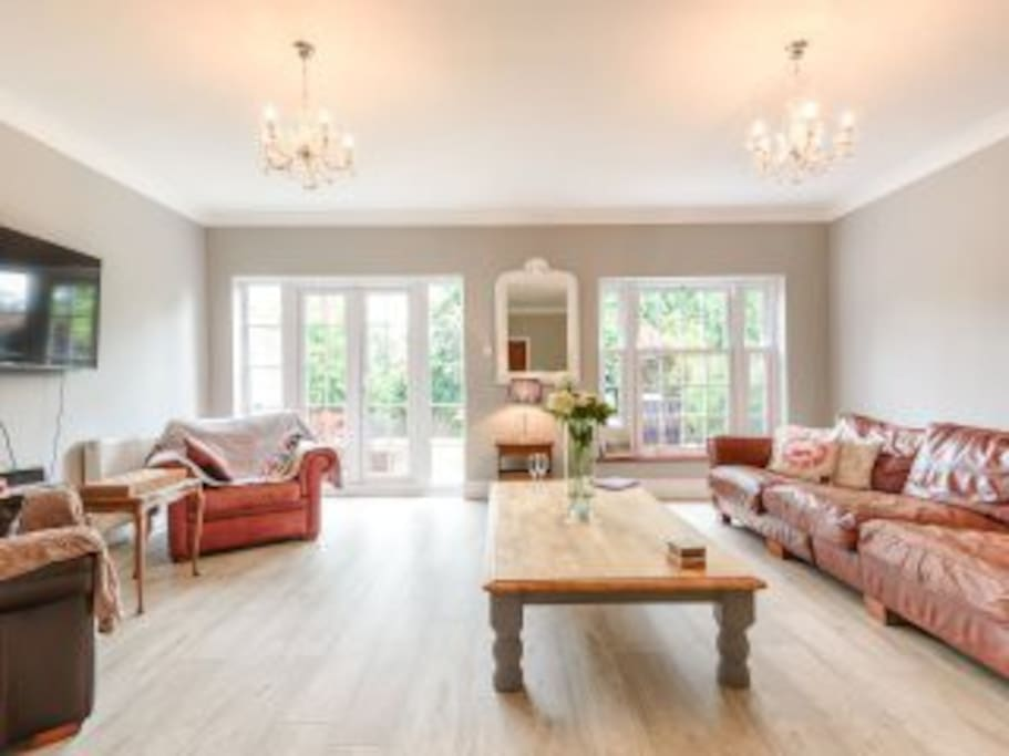 Perfect double living room with loads of seating and an outlook onto the garden