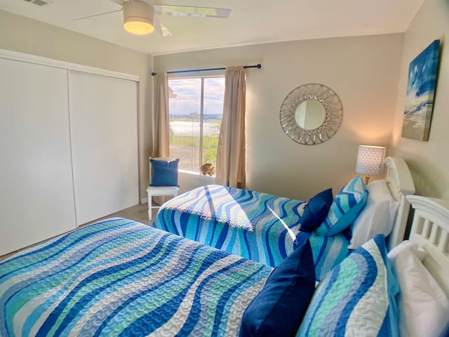 Guests enjoy lovely lake views from this 2-twin bedroom