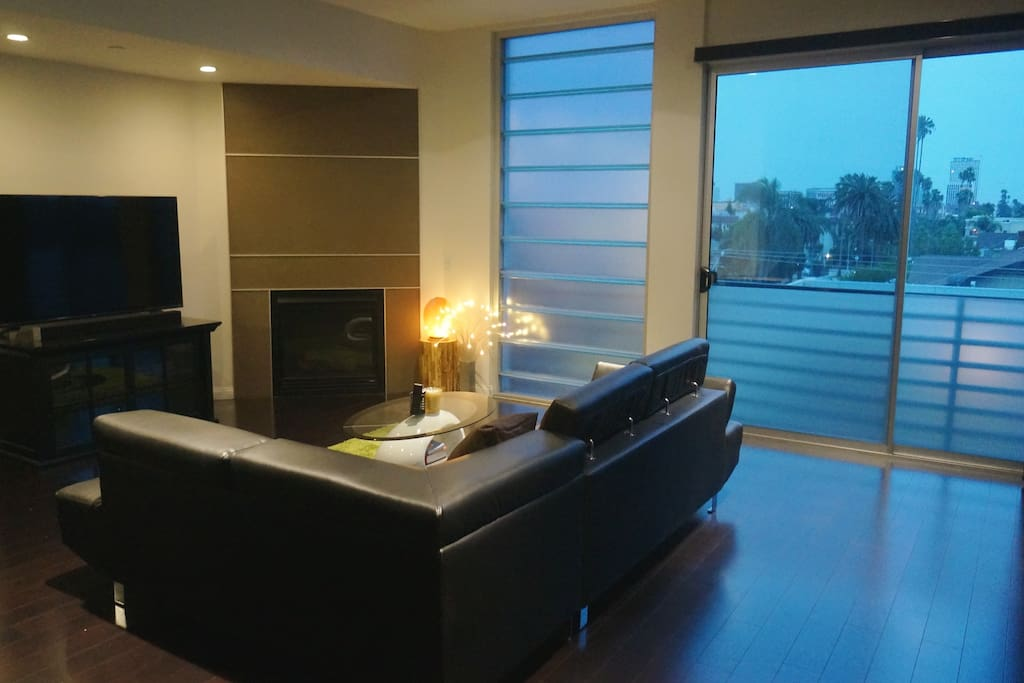 Spacious living area with large windows. Bright during the day.