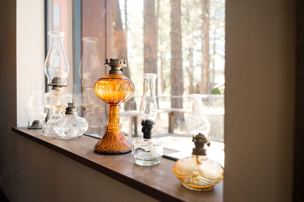 Antique oil lamps add to the rustic feel of the house