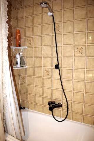 Upstairs bathroom has a full-size bathtub and stand-up shower.