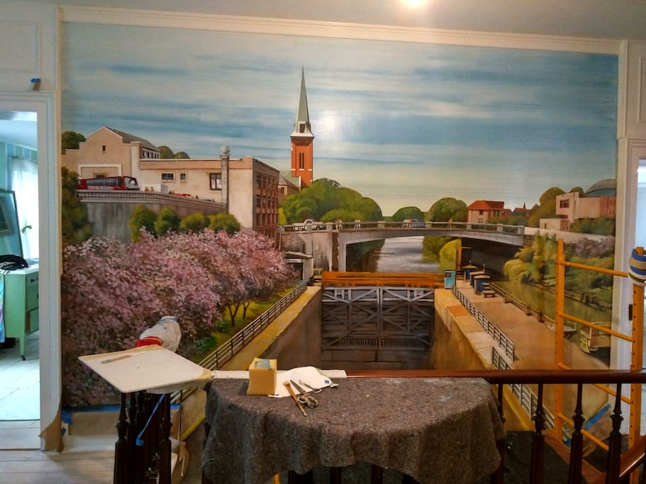 Right outside the Green Striped Bedroom, our newest addition to MOSCOW NIGHTS - A 12 ' tall, 16' tall mural (stretches all the way to the first floor!)  of the view to the Erie Canal in Lockport NY.