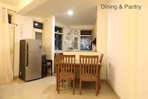 Living room - dining table and refrigerator