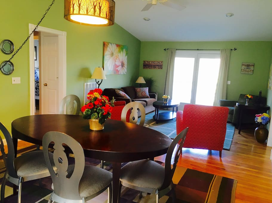 A picture when you first walk in front door - dining table & living room area