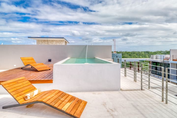 Secluded penthouse in the jungle of Tulum w/ views from private rooftop pool!