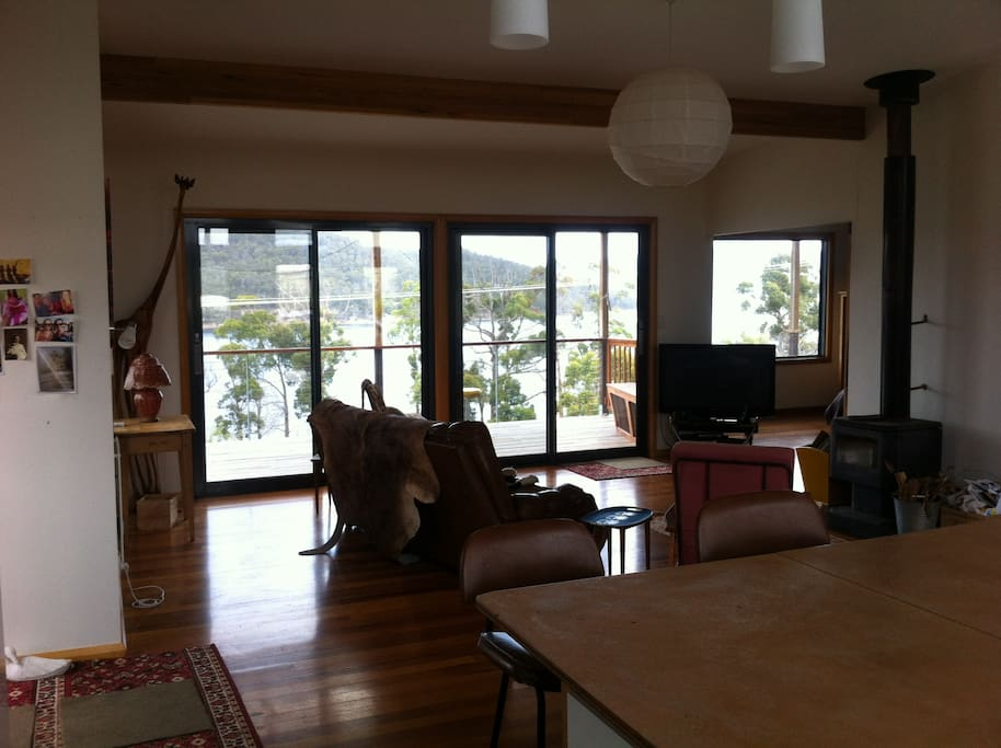 Open plan living area, with wood burning stove  overlooking the huon estuary