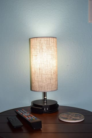 Matching lamps that not only light up the room, but have USB ports built in for your electronic charging needs.