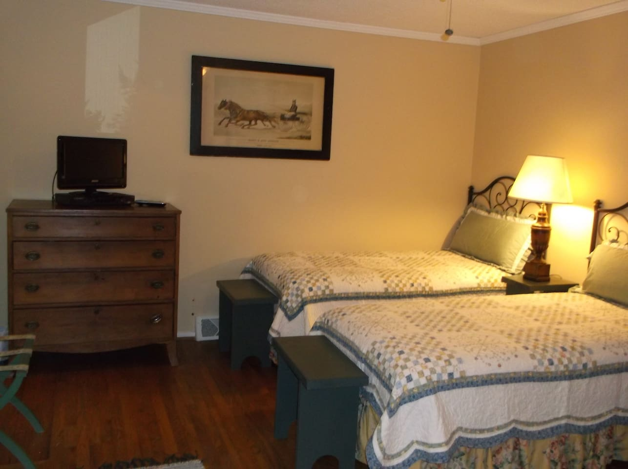 "'Comfy Charm enjoyed in lg. bedroom-sitting area,, private bathroom,, ""Snack Galley"" with small    counter & stools, refrigerator ,micro wave- guests love  THIS SUITE!"