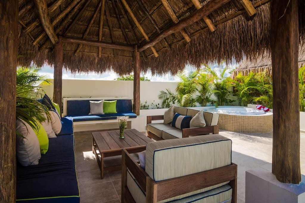 An oasis from the heat, your palapa offers shade and a comfy lounge to share tropical drinks for you and your friends