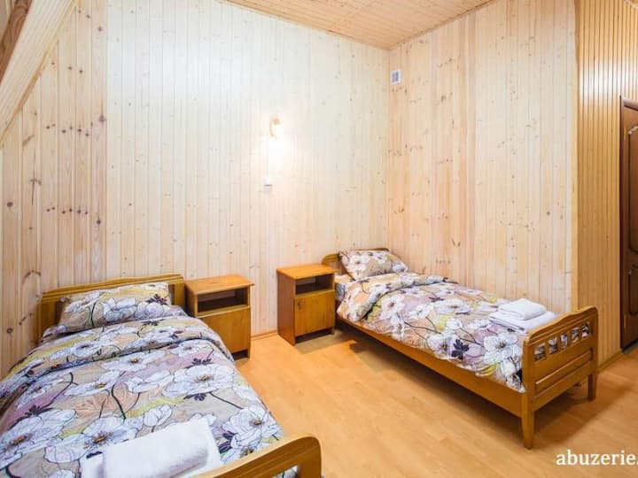 Standard double room with two separate beds. Abuzerye  will be glad to meet guests in the bosom of the picturesque Belarusian nature.