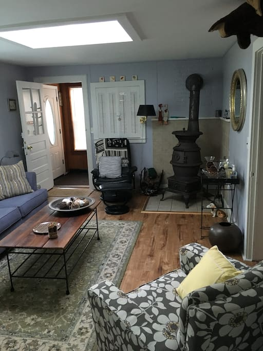 Living room with wood burning potbelly stove