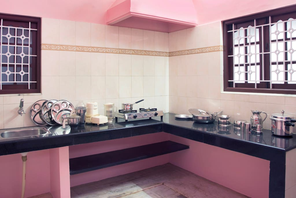 KITCHEN with mixcy,cooking vessels,plates,cooker,gas stove