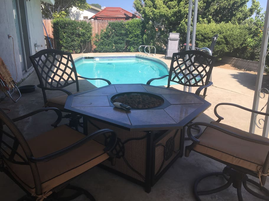 """Fire pit patio table perfect for dining or lounging, 37"""" TV facing patio."""