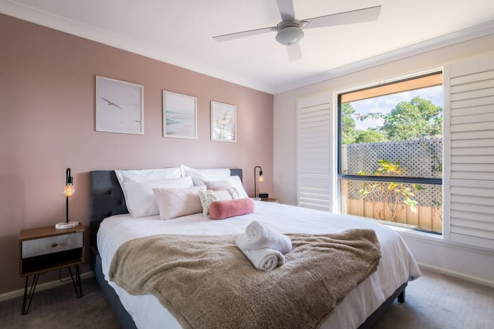 Master bedroom with King bed, ceiling fan, built in robe, TV and plantation shutters