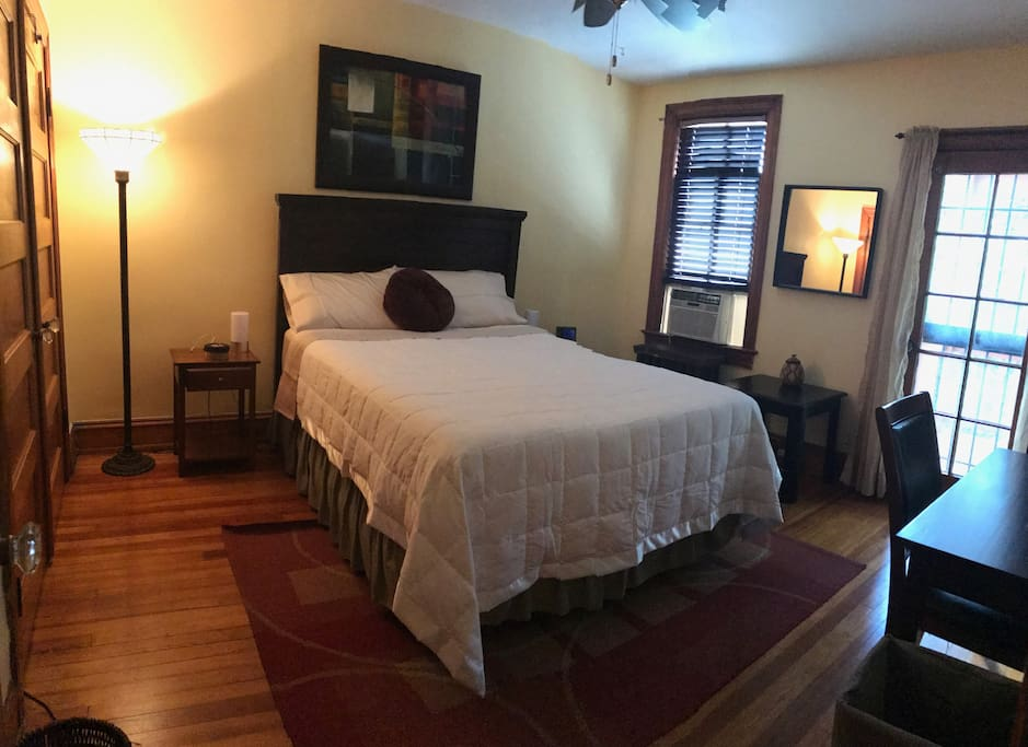 The large back bedroom offers a queen bed and private porch