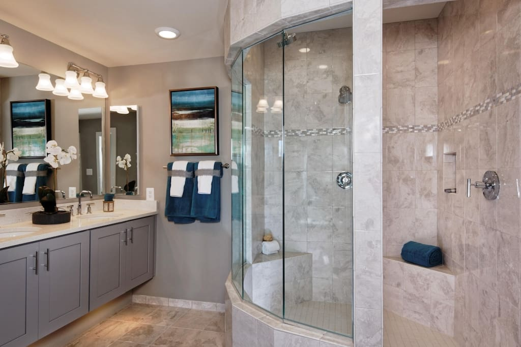 Masterbedroom bath, double vanity, double shower heads and toilet located inside water closet.