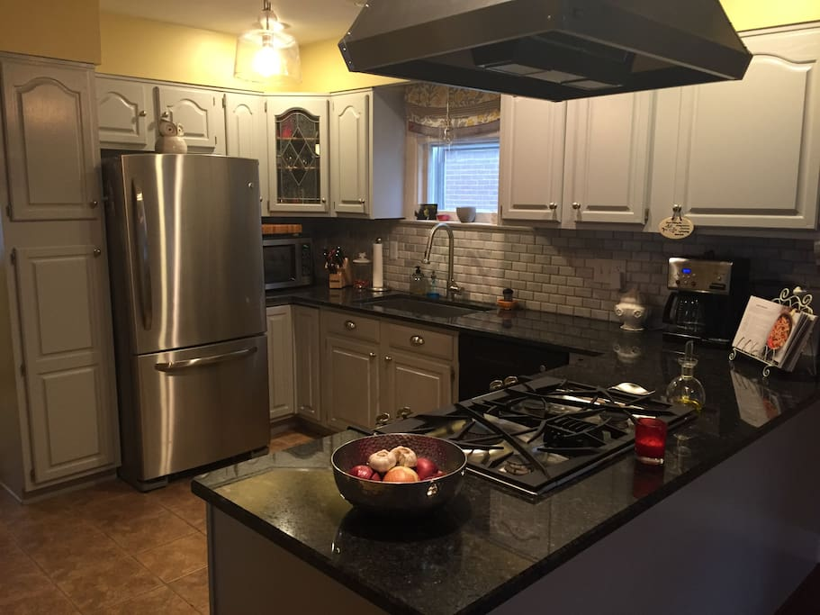 Kitchen with granite counter tops and updated appliances