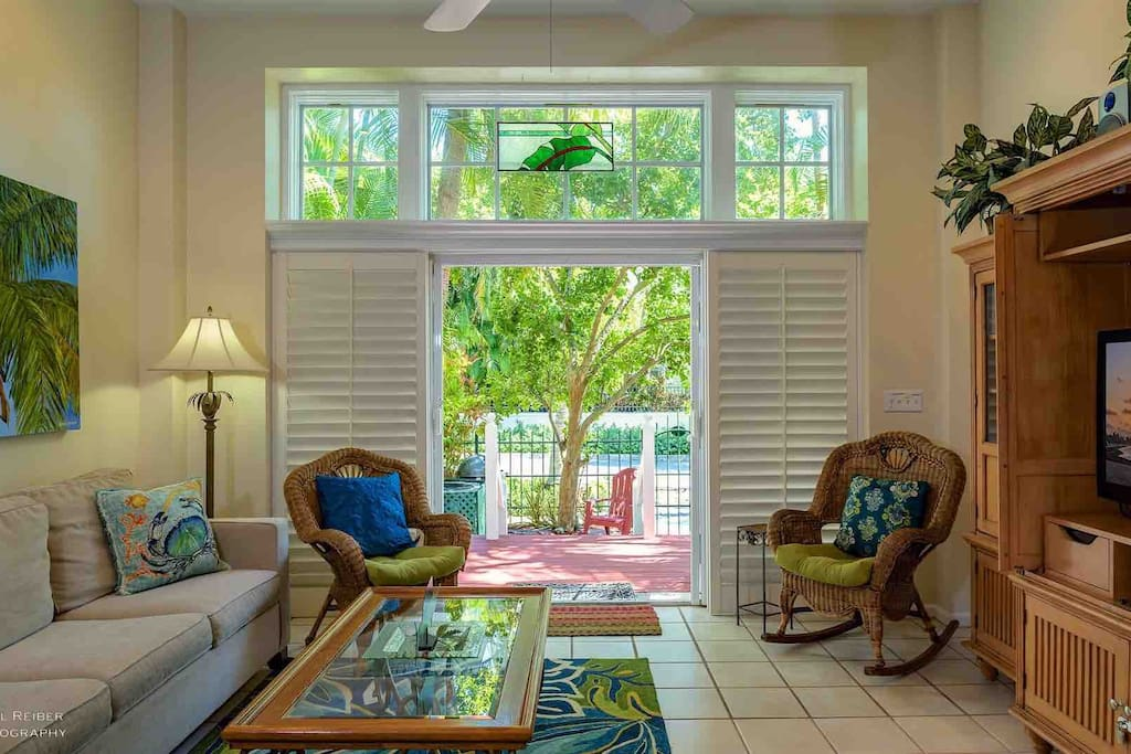 The living room French doors open up to the front porch and private courtyard...