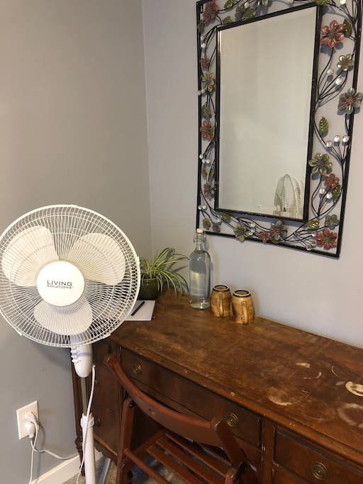 We also provide a desk, mirror, fan, and water glasses for your convenience.