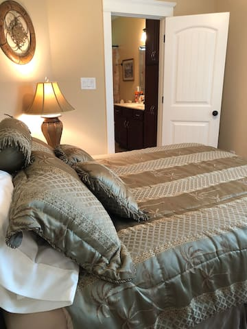 Queen Suite #1 with En Suite Full Bath and Walk-In Closet and Pack n Play