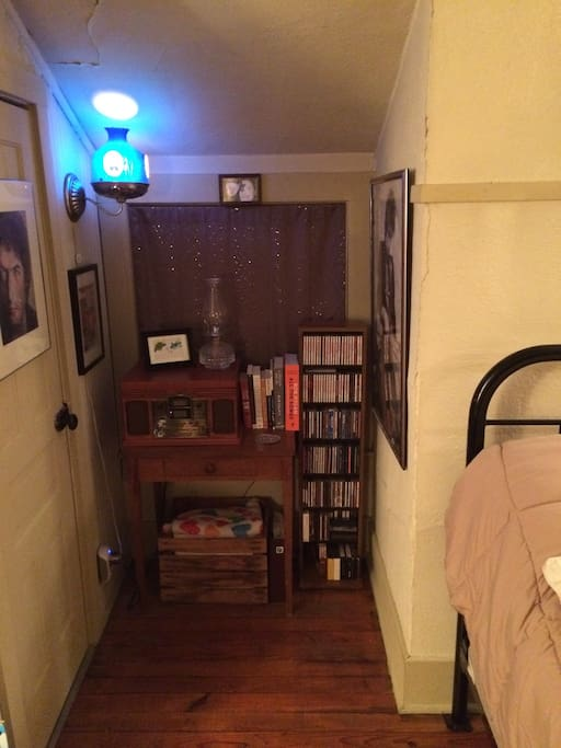 This small nook is home to a record player/cd player and large walk in closet on the left. Records and cd's are available for listening during your stay.