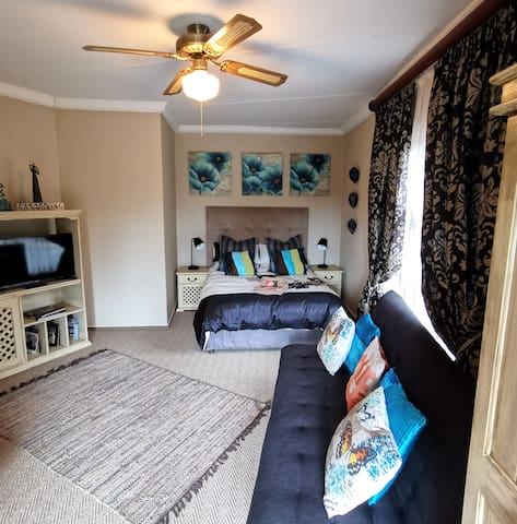Large Bedroom with own lounge area, TV and Neflix.