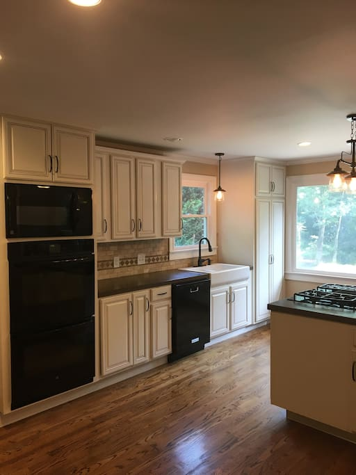 The kitchen is both beautiful and functional with concrete counter tops, double ovens and the cabinets are stocked with everything you need to entertain.