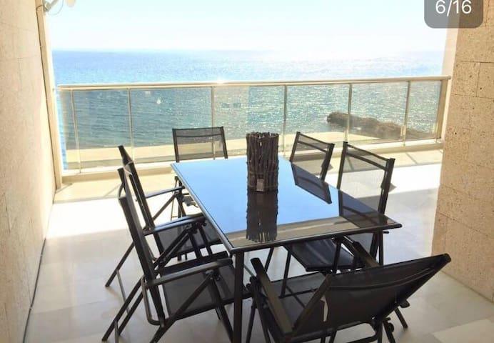 Dining outsdoors with wonderful sea views.