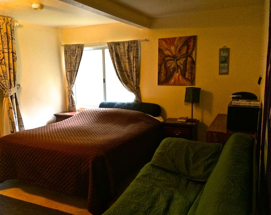 Your room! Queen-size bed, pull-out futon and coffee station (with microwave and fridge)