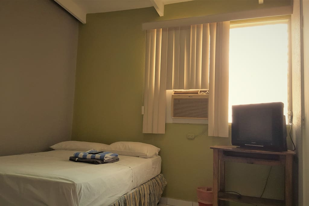 A private room with Double Bed, TV and optional air conditioning.