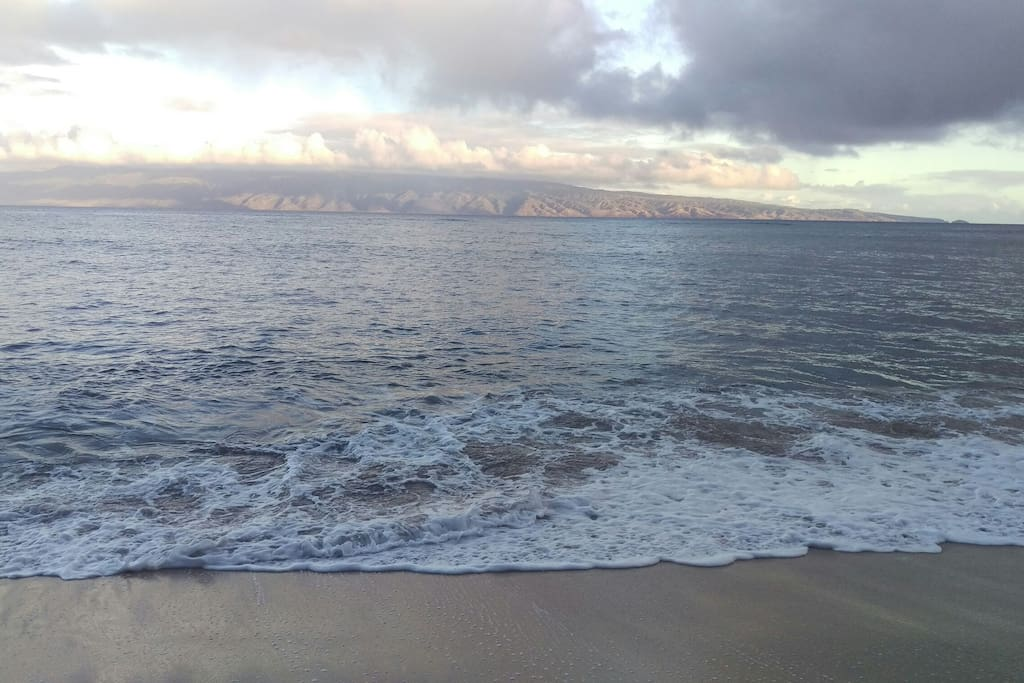Early morning sunlight on the horizon from Sands of Kahana beach, a 3 minute walk from condo. Island of Molokai in the distance. Island of Lanai on the left...
