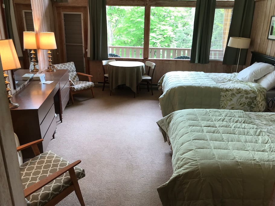 Our lodge rooms have a retro decor, 2 queen beds and a private bath.