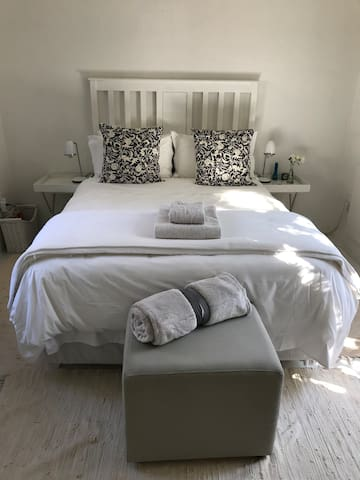 The clean interior of the room. It has a double bed