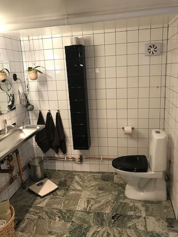 Bathroom with tub and shower. Shared.
