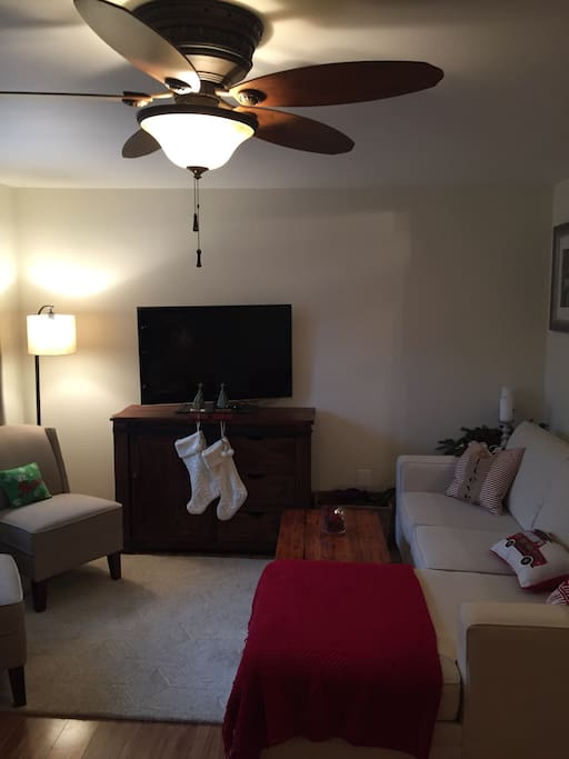 Family room with tv, couch and 2 charis