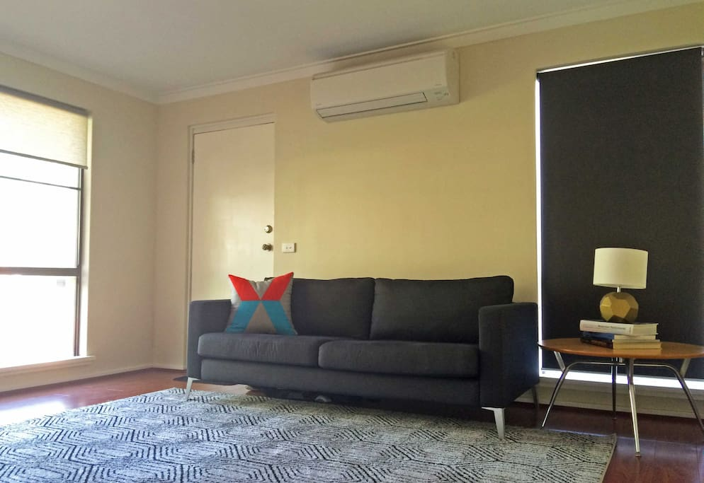 Light and bright living room with new Air Conditioning.