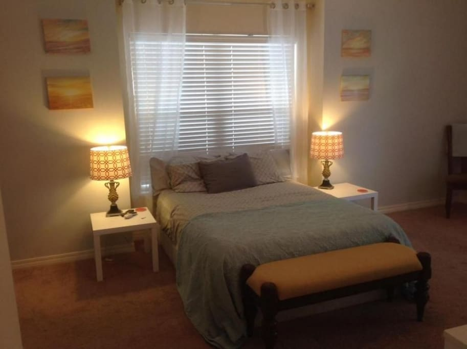 Larger room with queen bed and fits a queen air mattress.
