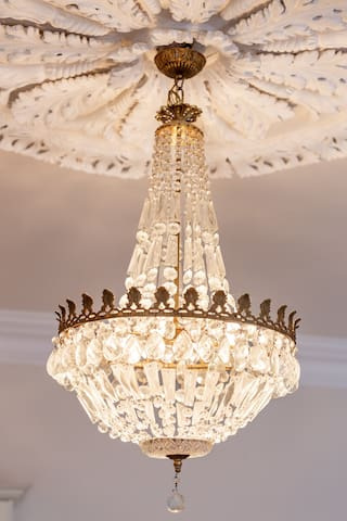 """""""A beautiful chandelier over the bed gave it a romantic feel."""" Antique French Empire-Crystal-Chandelier creates a relaxing ambience that exudes a timeless luxury."""