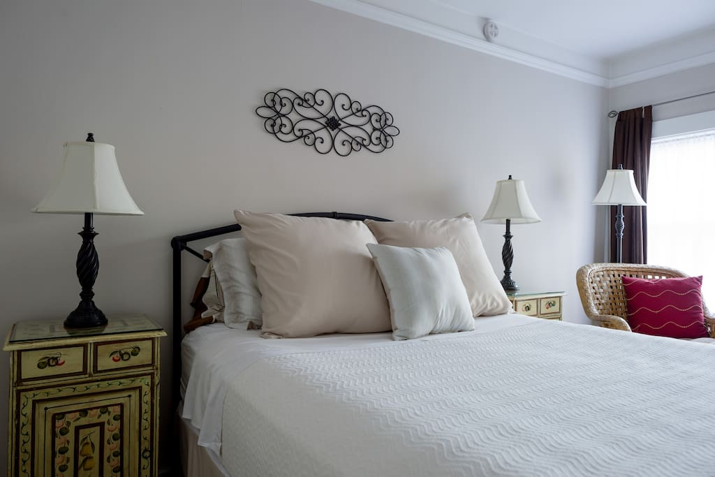 Private, cozy bedroom with queen mattress and reading area.